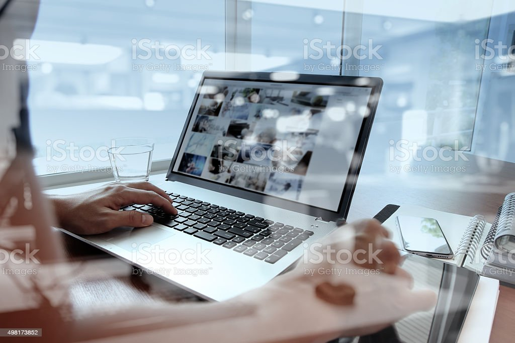 double exposure of business man hand working on laptop computer stock photo