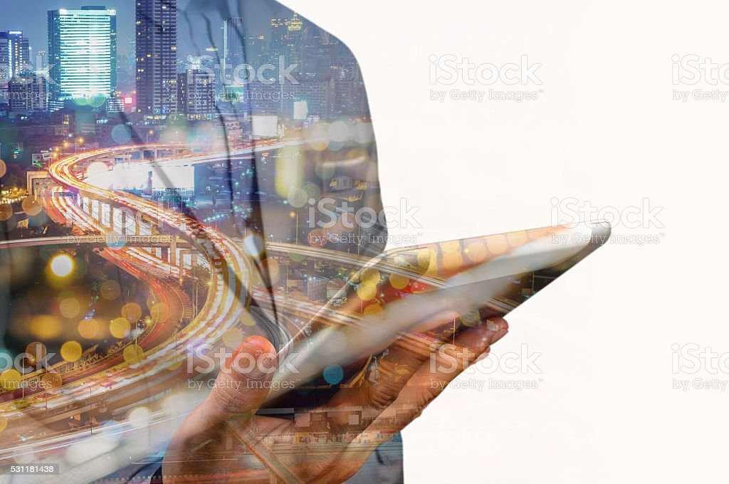 Double exposure of Business Man use Mobile SmartPhone with Urban stock photo