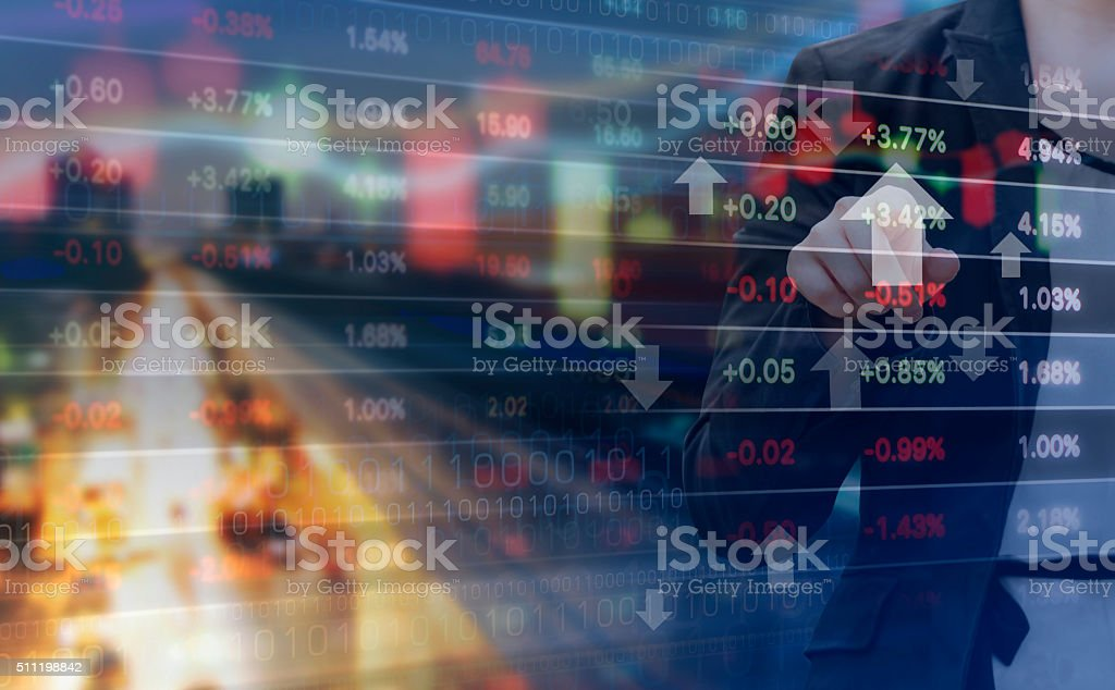 Double exposure of business woman and stock market graph stock photo
