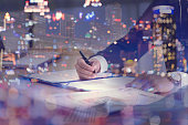 Double exposure of businessman and cityscape - Business concept