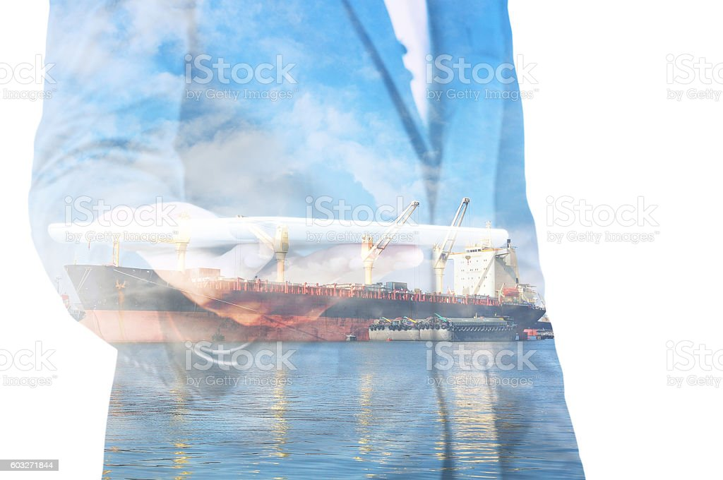 Double exposure of businessman hand hold tablet, cargo port ship stock photo