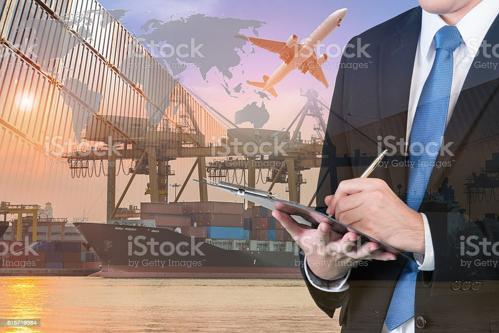 Double exposure of businessman is booking with blurred cargo stock photo