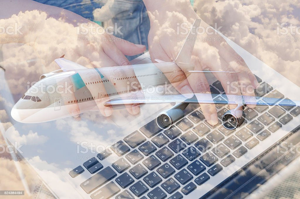 Double Exposure of Businessman Use Computer Notebook with Airplane stock photo