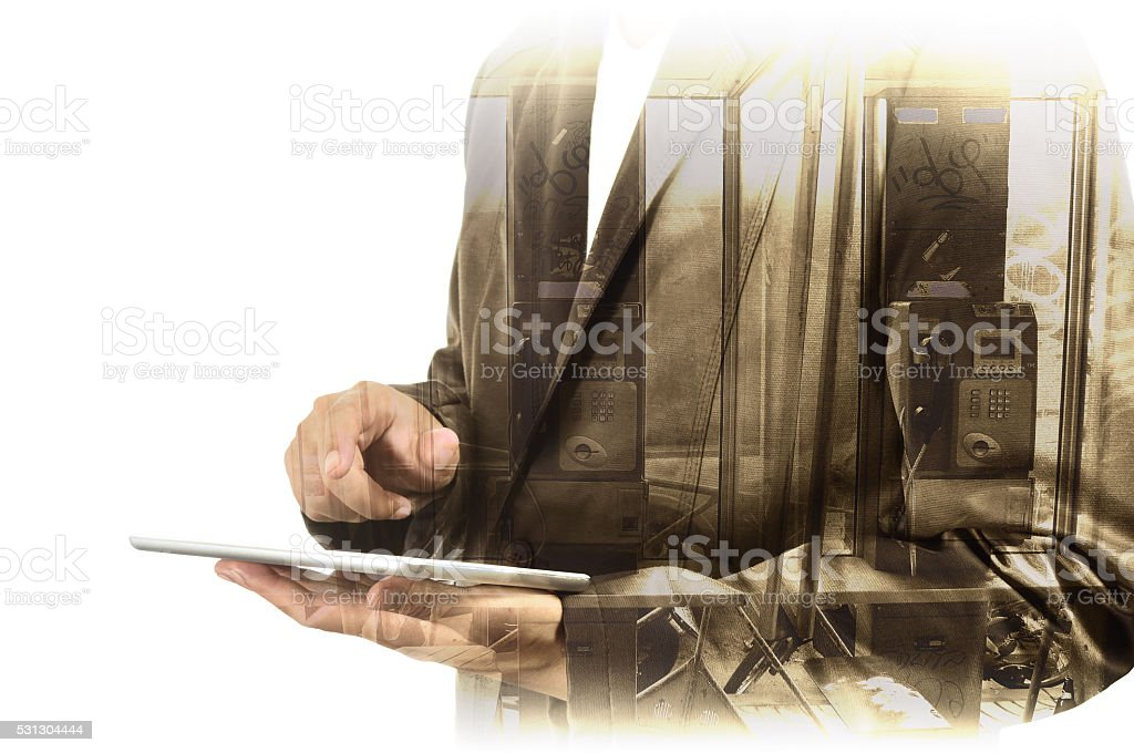 Double Exposure of Businessman use Computer Tablet with Phone Bo stock photo