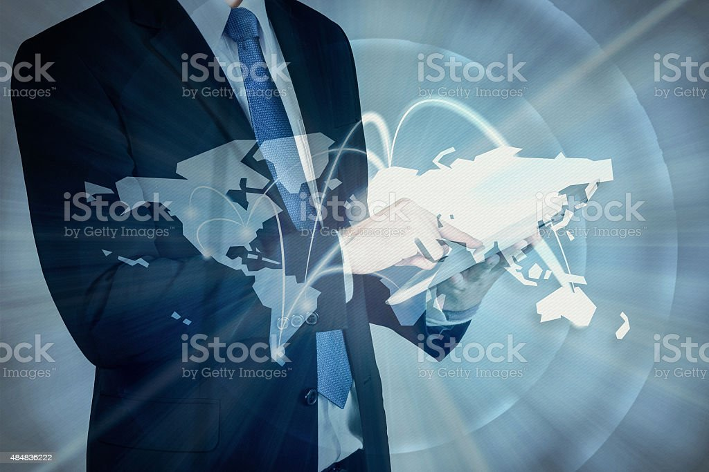 Double exposure of businessman using digital tablet show Global stock photo
