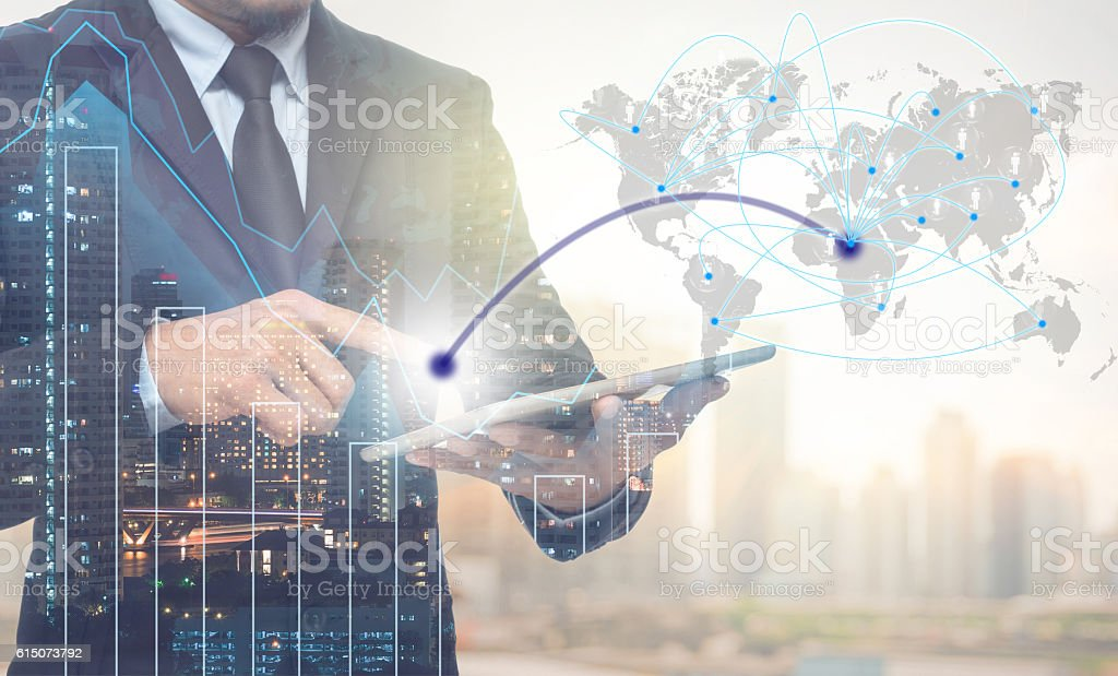 Double exposure of businessman using tablet for connection stock photo
