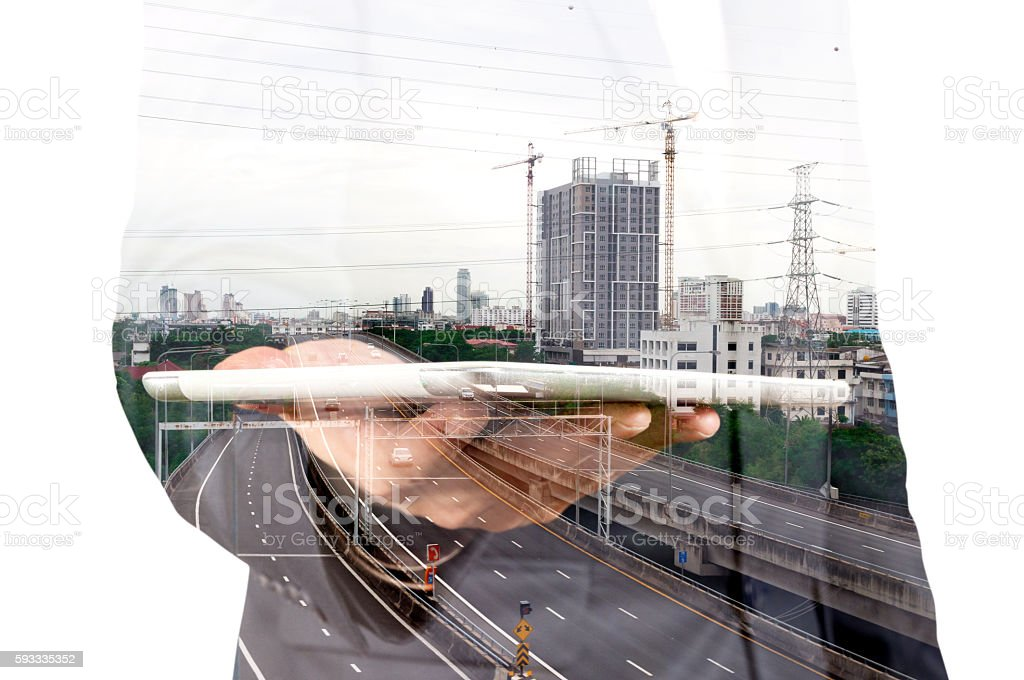 Double exposure of Businessman with Tablet and Modern City Build stock photo