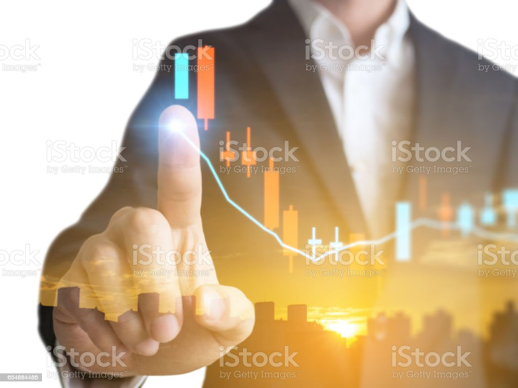 Double exposure of businessman with Trading graph on the cityscape background,Business financial concept stock photo