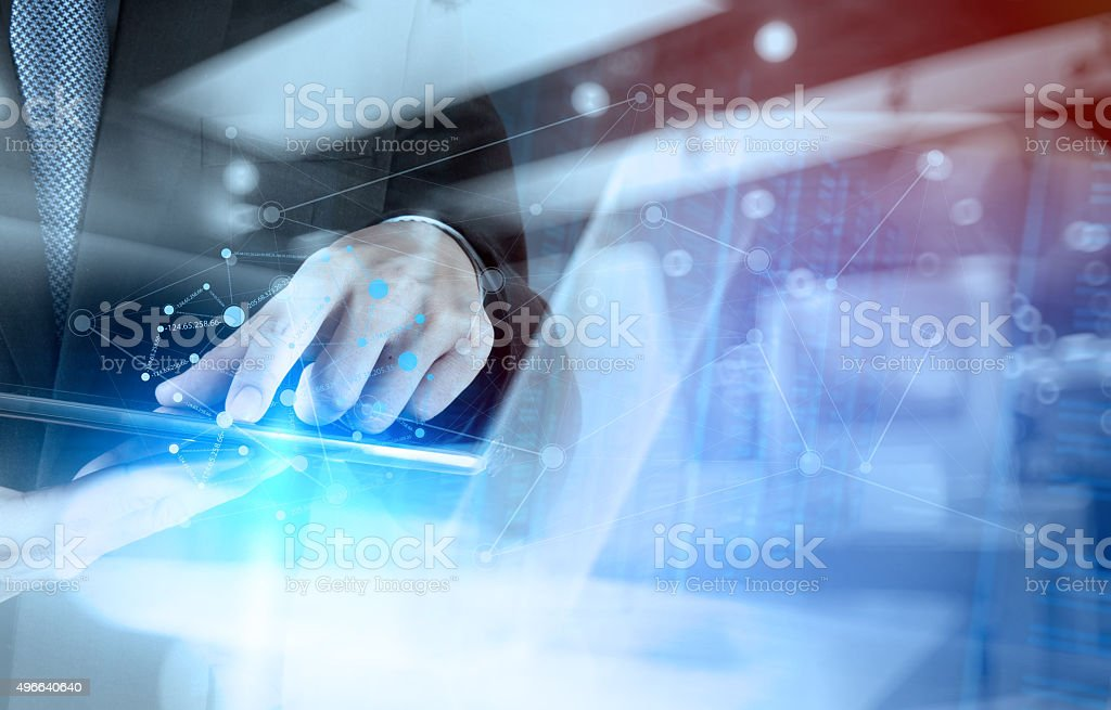 Double exposure of businessman working with new modern computer stock photo
