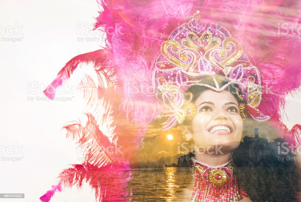 Double exposure of cheerful samba dancer and beautiful lake sunset stock photo