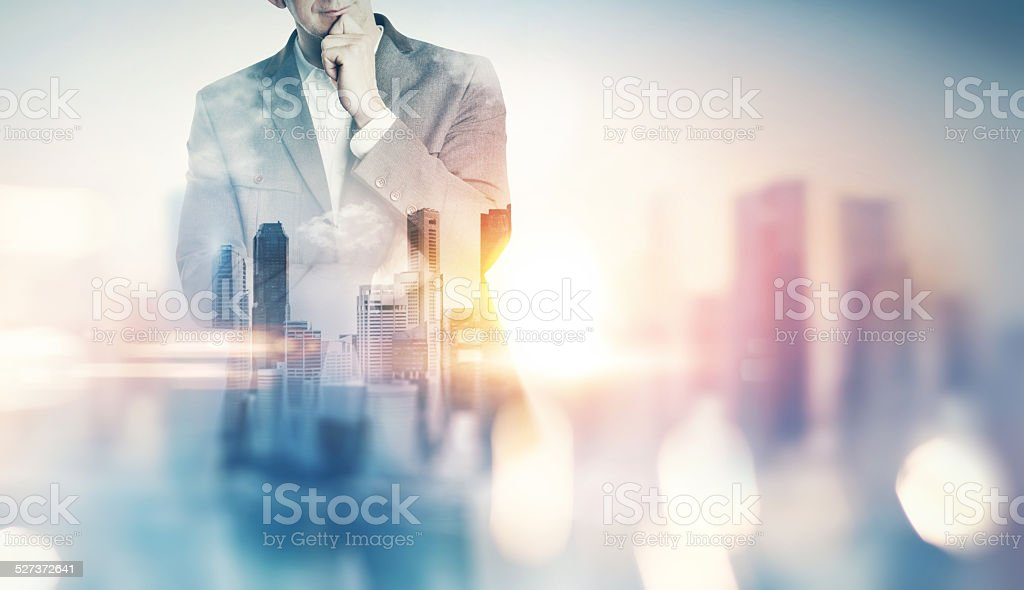 Double exposure of city and business man with light effects stock photo