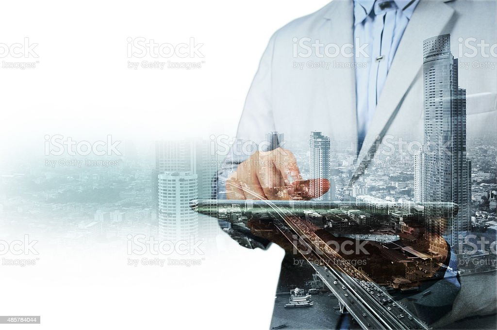 Double exposure of city and businessman on the phone stock photo