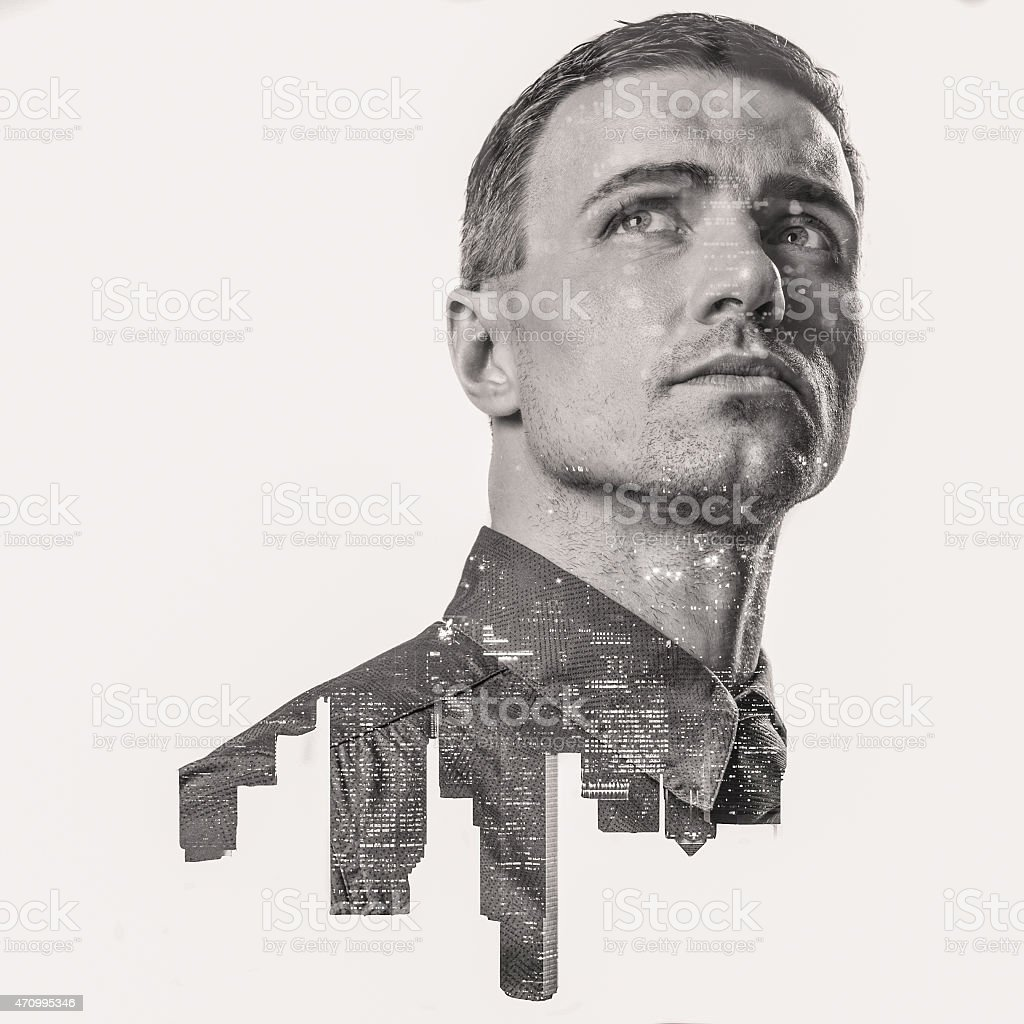 Double exposure of city skyline and businessman in grayscale stock photo