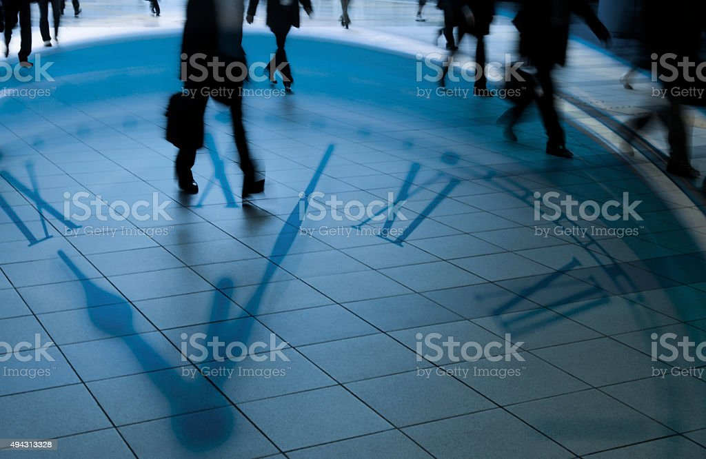 Double Exposure of Clock and Commuters stock photo