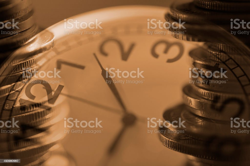 Double Exposure of Coins and Pocket Watch stock photo