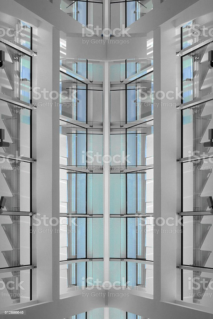Double exposure of corner / staircase hall with extensive windows stock photo