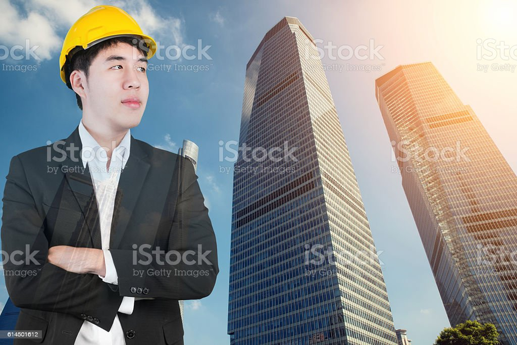Double exposure of Engineer looking forward in city. stock photo