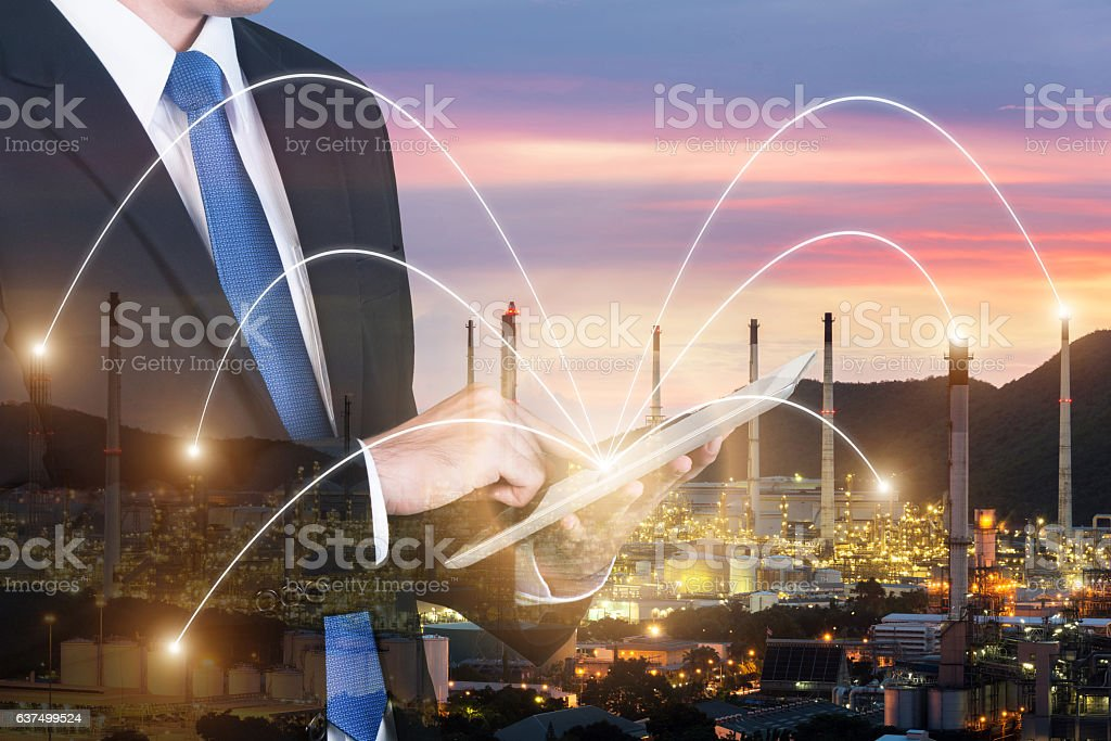 Double exposure of engineer using digital tablet pc assistance stock photo