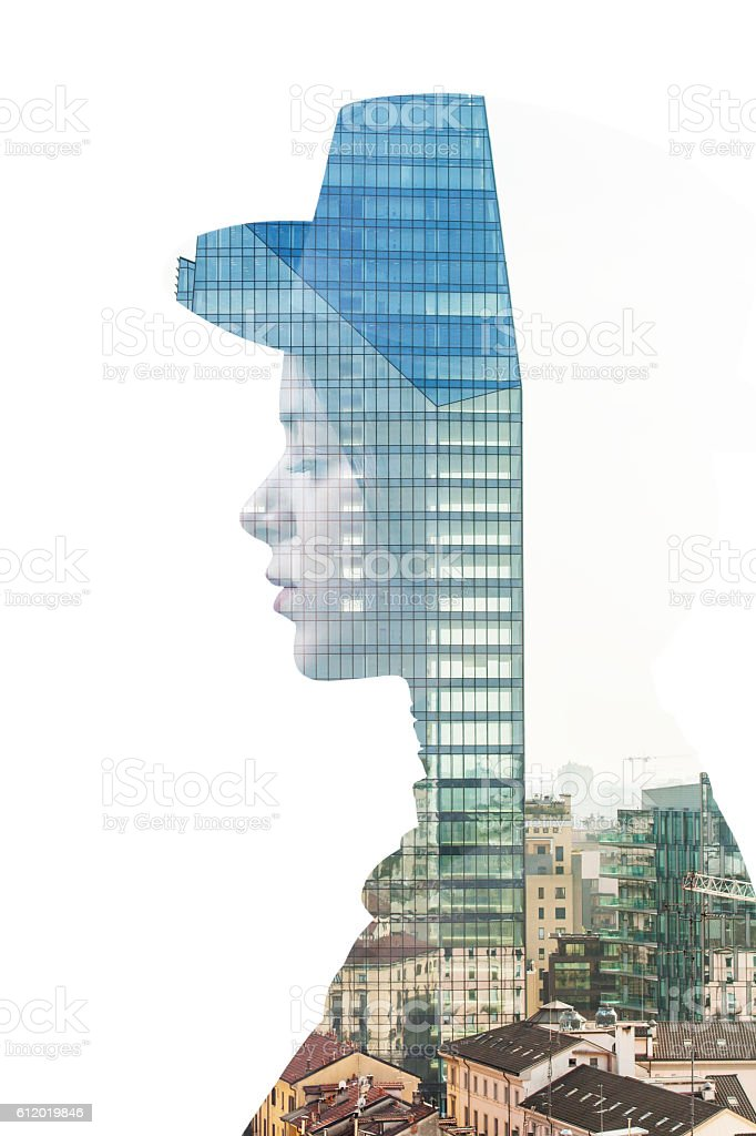 Double exposure of girl wearing hat and city skyscraper stock photo