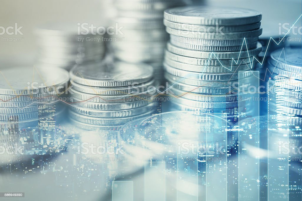 Double exposure of graph and rows of coins stock photo