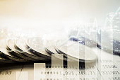 Double exposure of graph and rows of coins