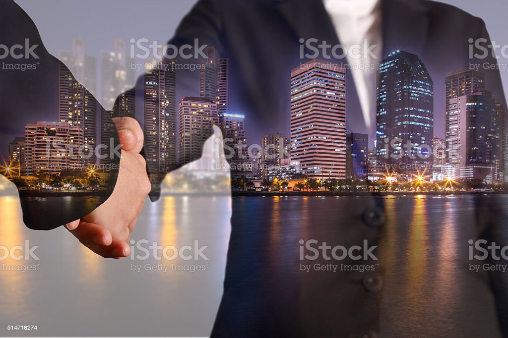 Double exposure of handshake night city, urban and lake stock photo