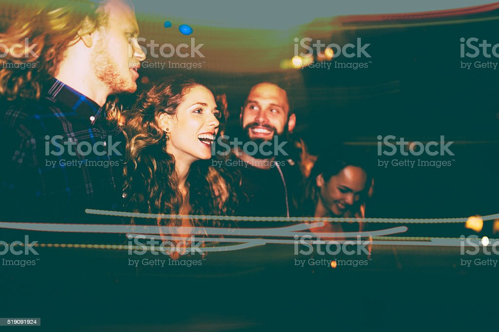 Double exposure of hipster friends enjoying night life stock photo