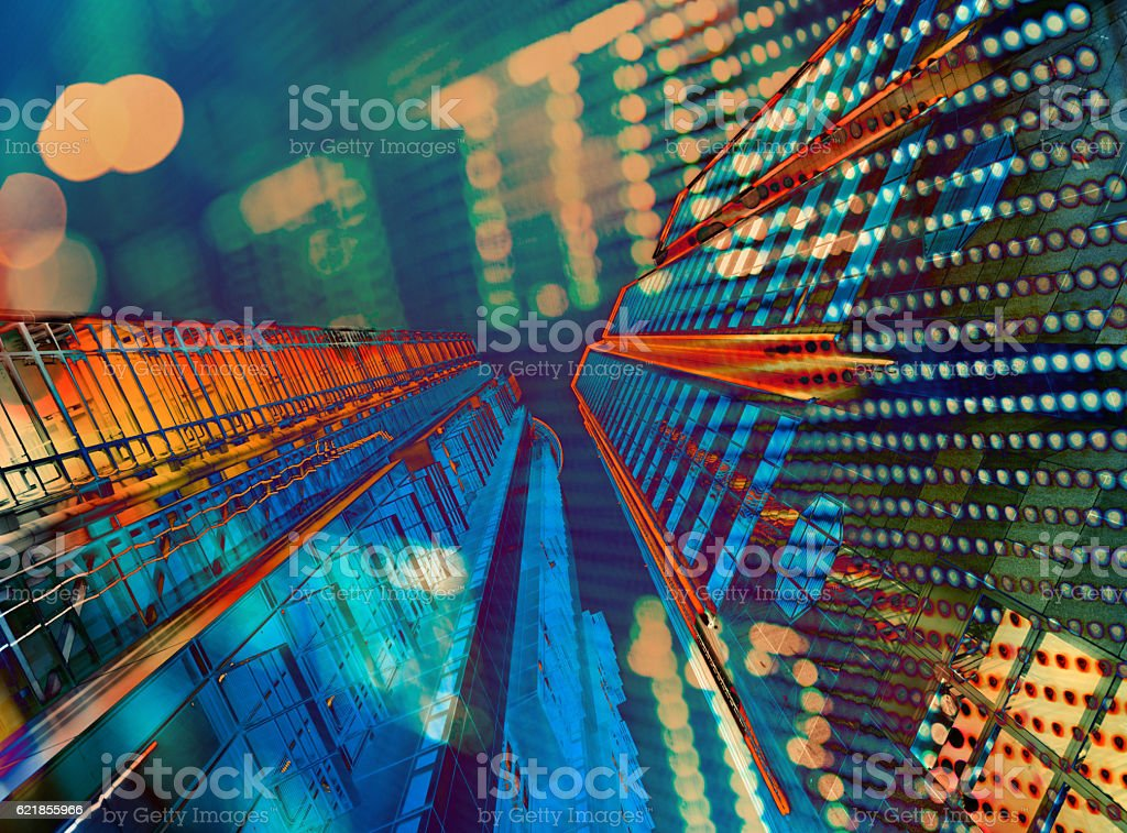 Double exposure of Hong kong business towers at night stock photo