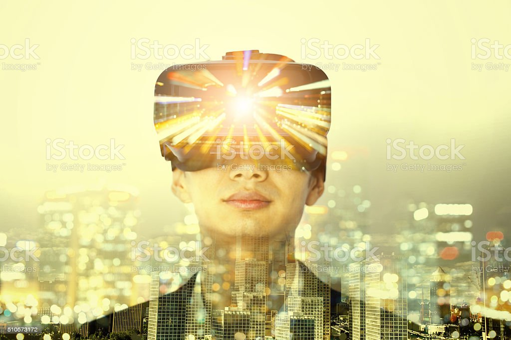 Double exposure of man wearing virtual reality headset stock photo