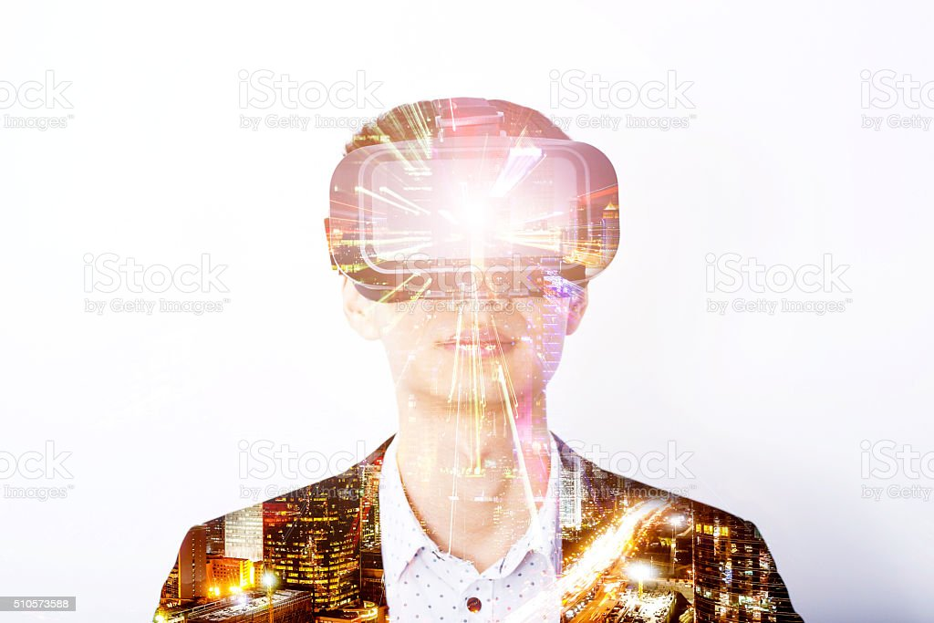 Double exposure of man wearing virtual reality headset stock photo