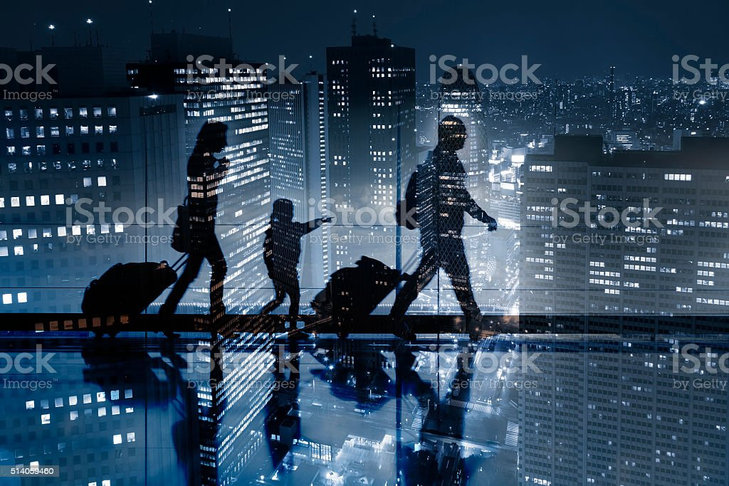 Double exposure of passengers walking and aerial view of city stock photo