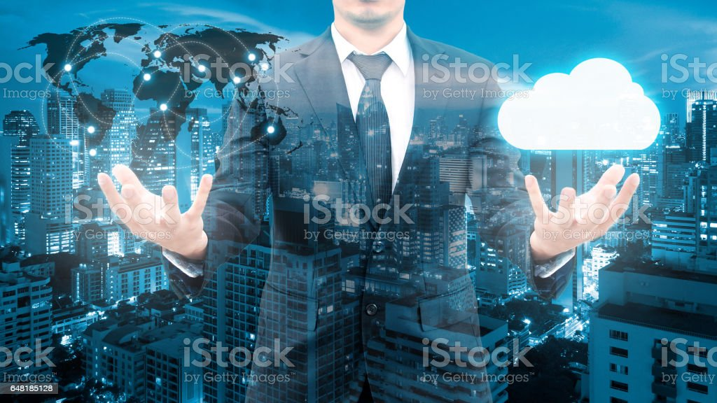 Double exposure of professional businessman cloud technology and network connection with blurred cityscape in communication , technology and business concept, element of this image furnished by NASA stock photo