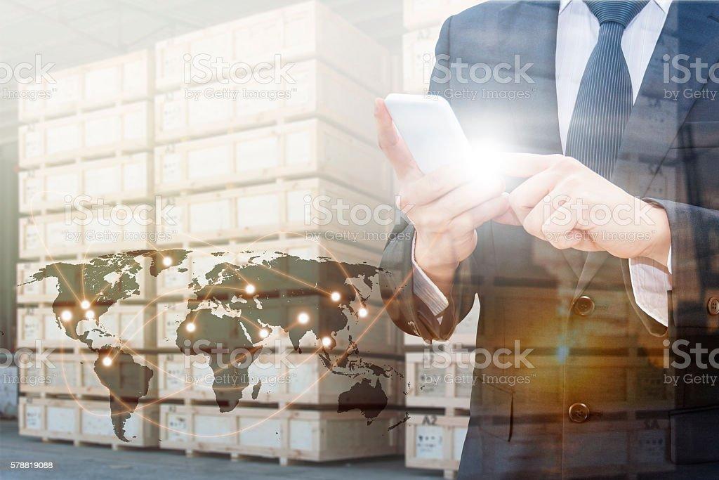 Double exposure of professional businessman using smart phone stock photo