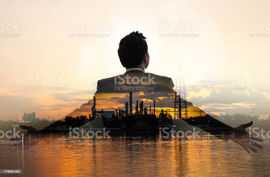 Double exposure of refinery oil and gas stock photo