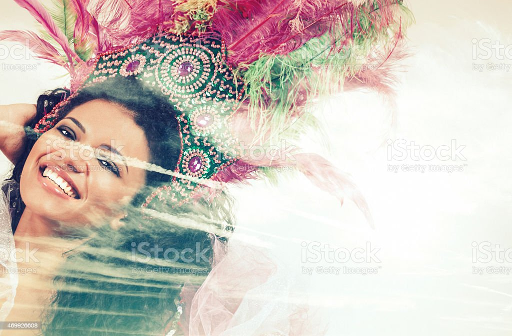 Double exposure of samba dancer and clouds stock photo