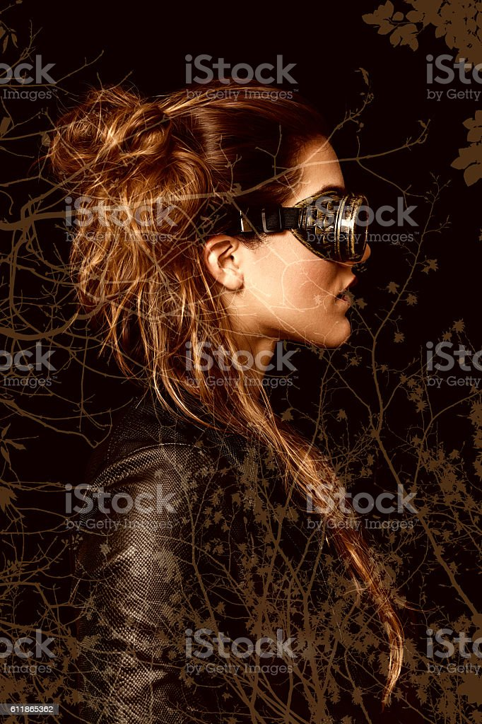 Double exposure of steampunk woman and autumn tree branches stock photo