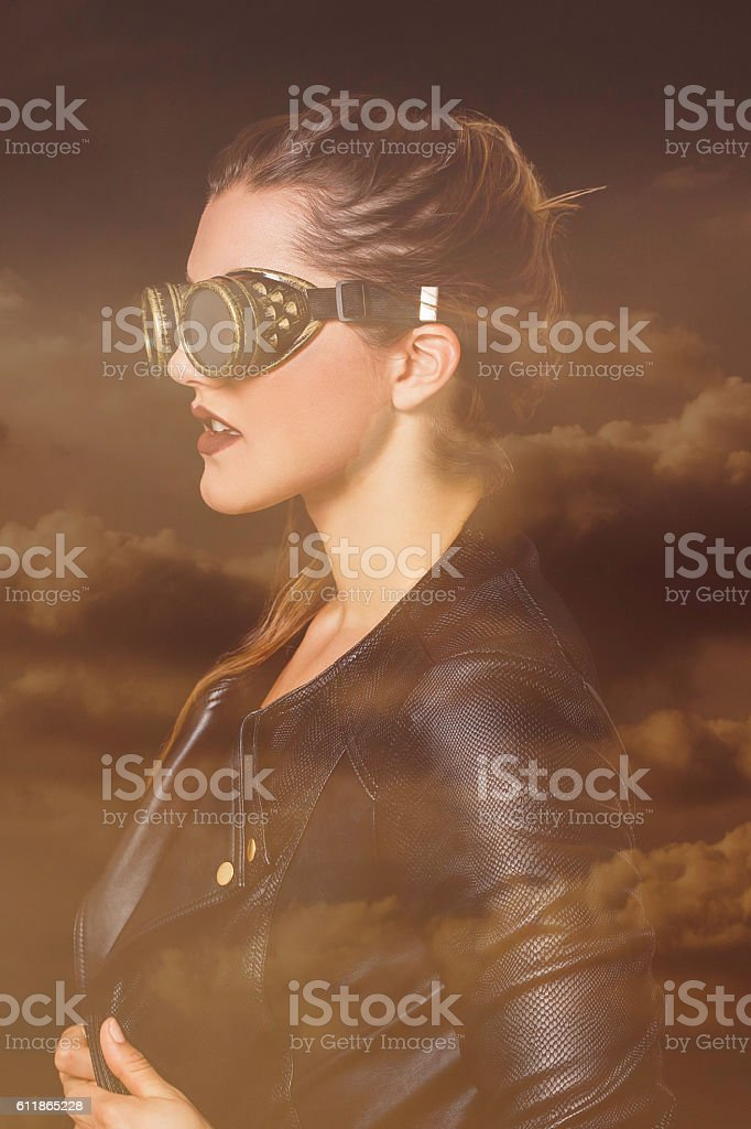 Double exposure of steampunk woman and sunset cloudscape stock photo
