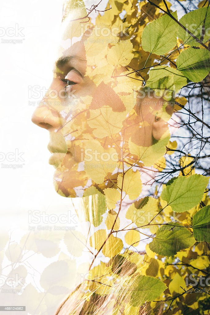 Double exposure of woman combined with photograph of leaves stock photo