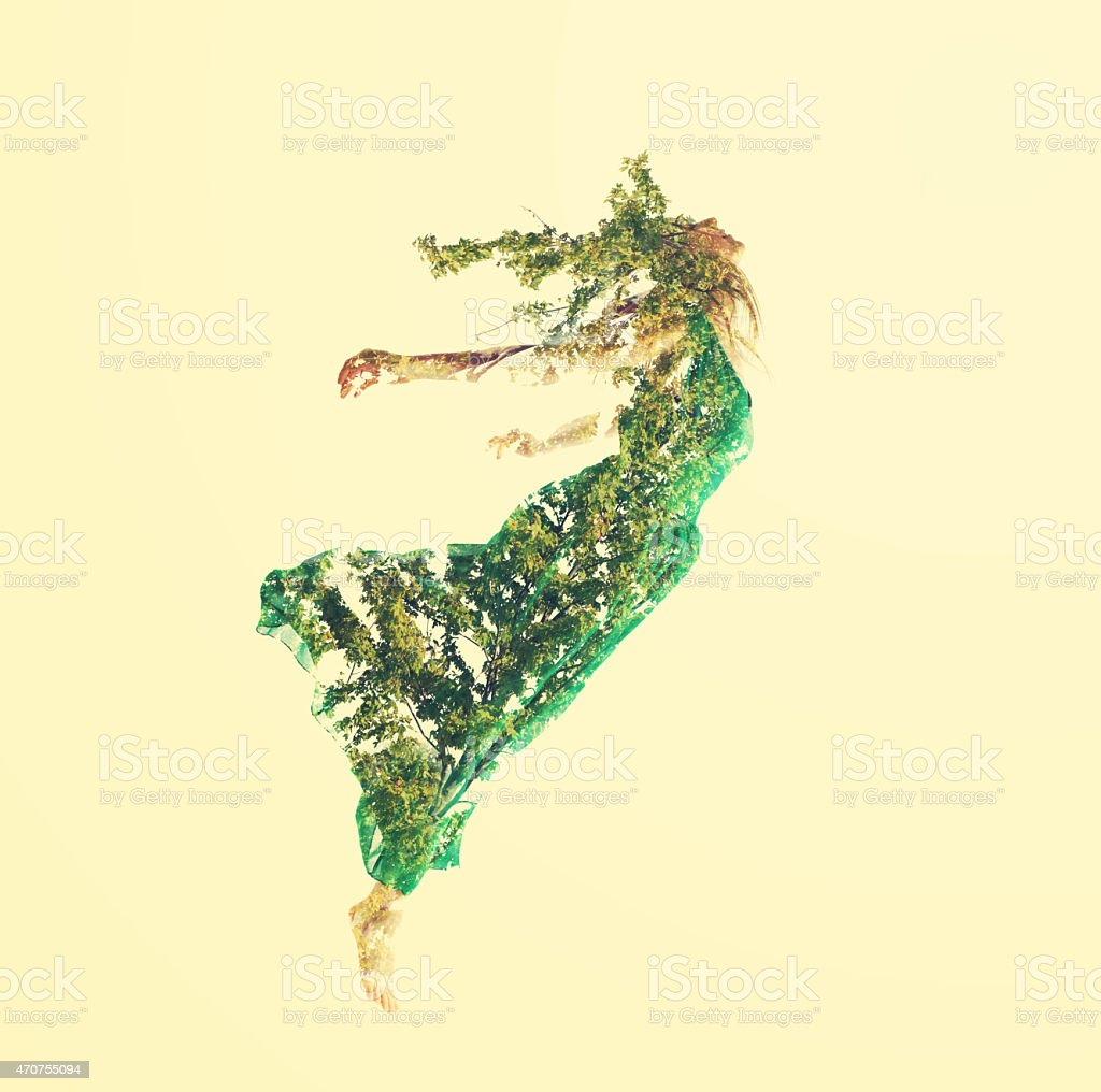 Double exposure of woman flying with leaves stock photo