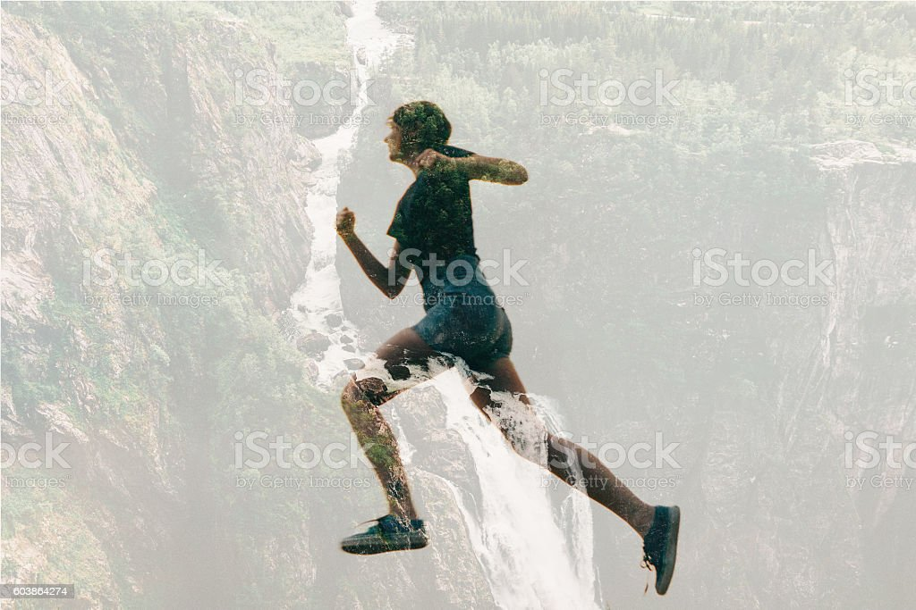 Double exposure of woman running and waterfall stock photo
