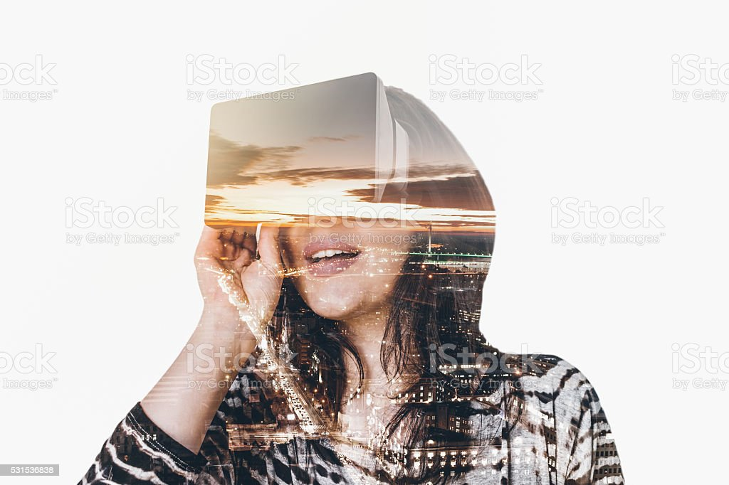 Double exposure of woman wearing virtual reality simulator stock photo
