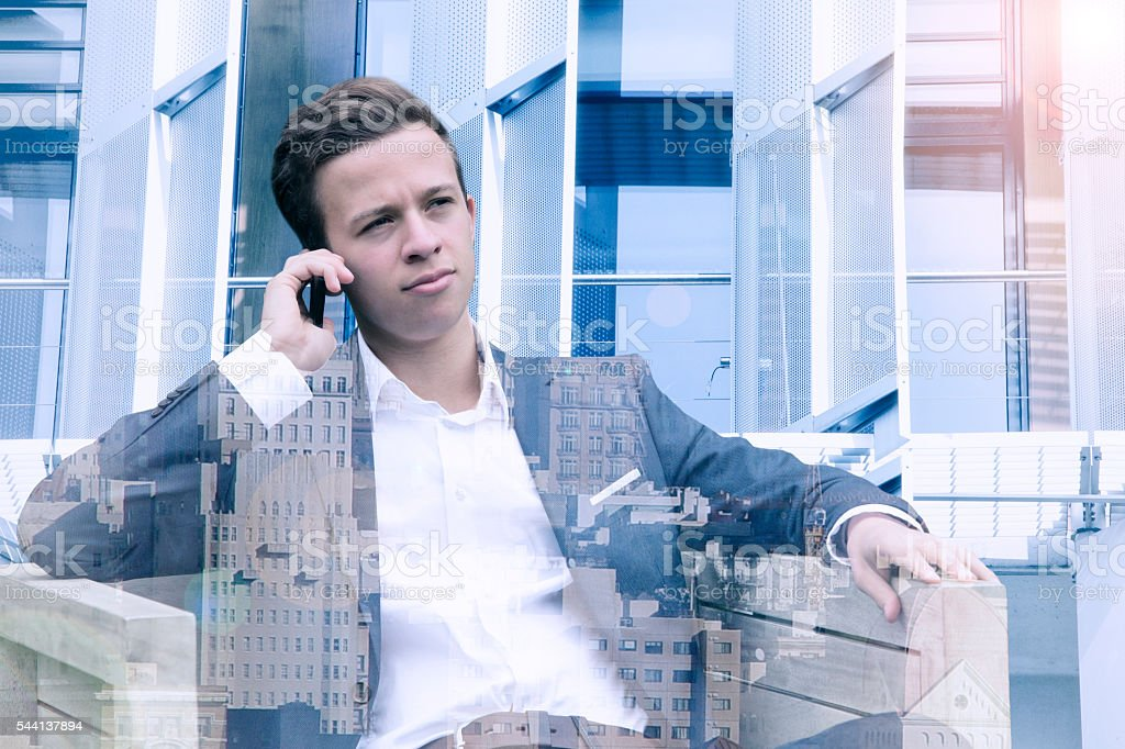 double exposure of young man on phone and cityscape stock photo