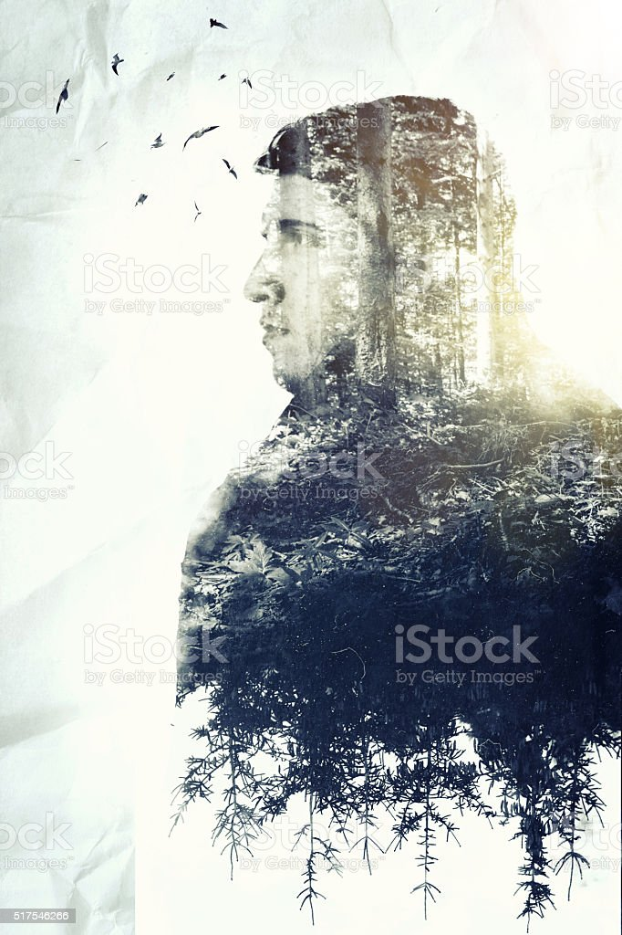 double exposure of young thoughtful man who loves nature stock photo