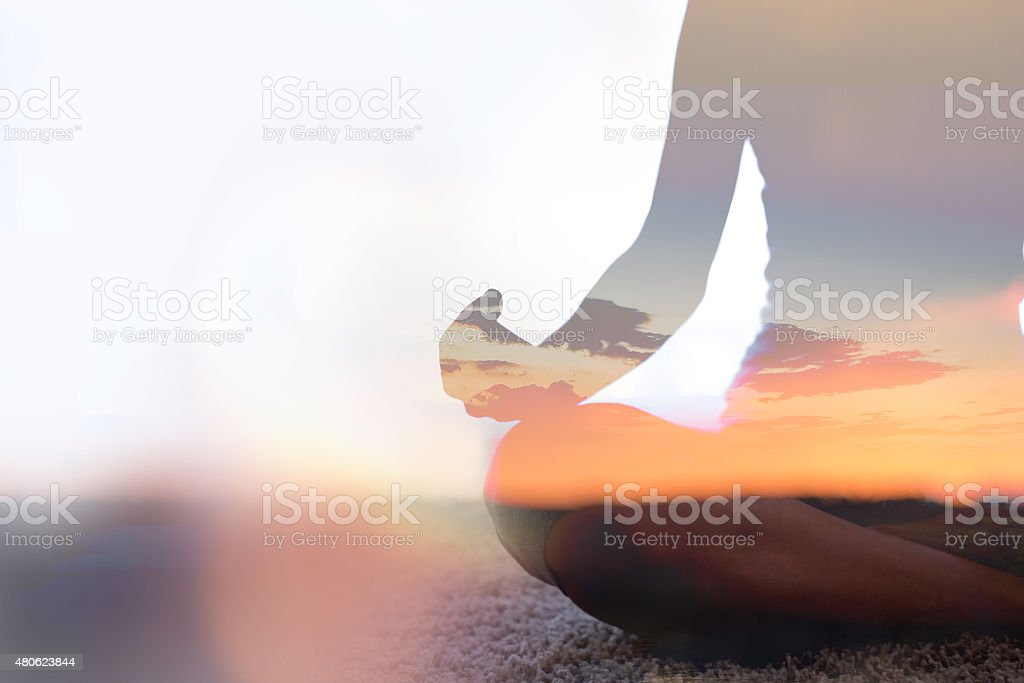 Double exposure of young woman  practicing yoga in nature stock photo