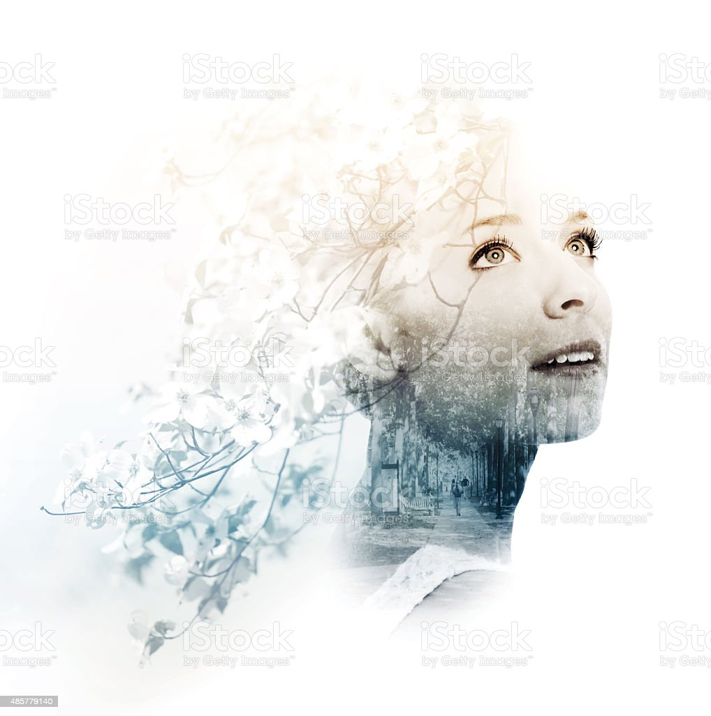 Double exposure of young woman with street and doogwood stock photo