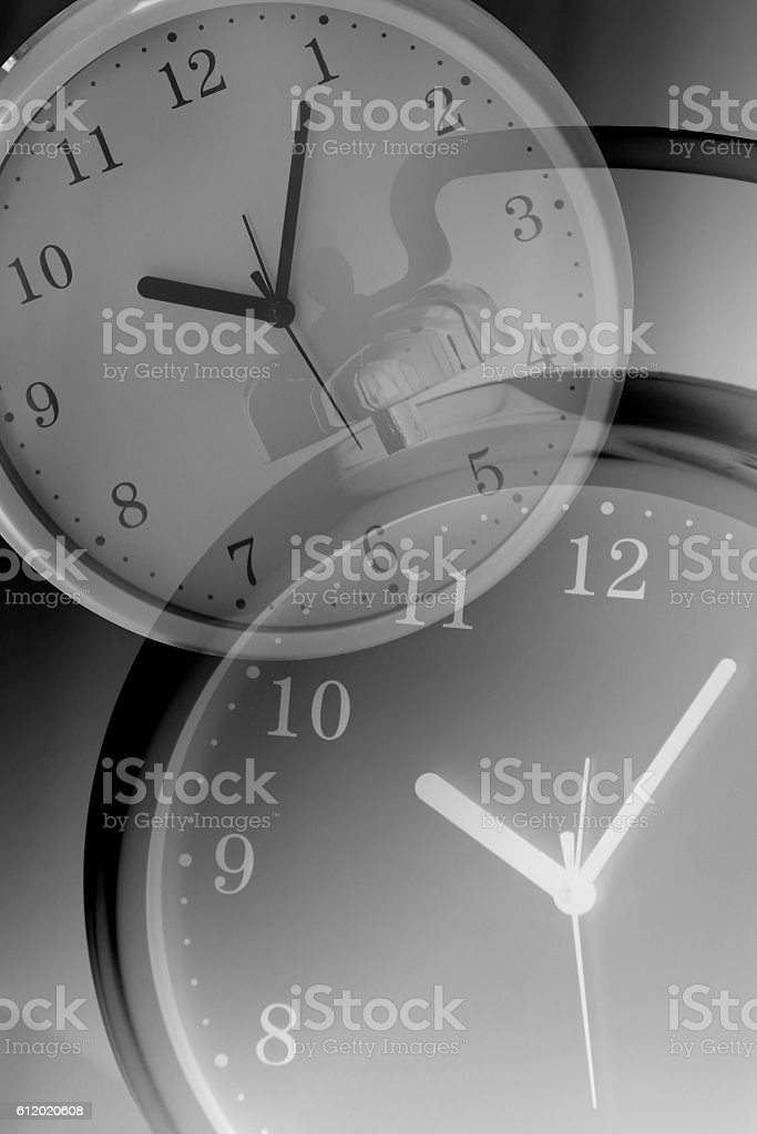Double exposure photo of clock faces. Metaphor of time management. stock photo