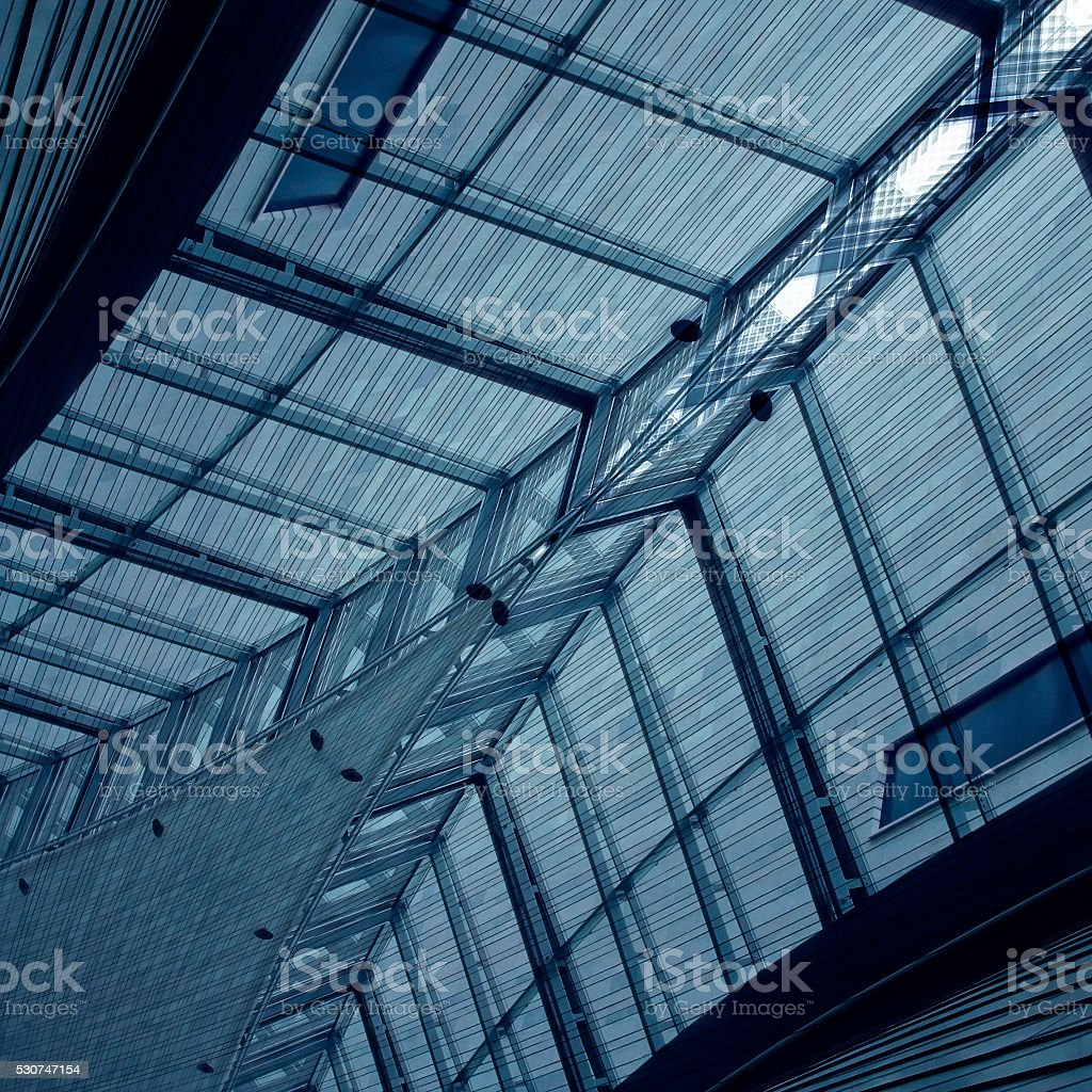 Double exposure photo of modular steel-and-glass architectural structure stock photo