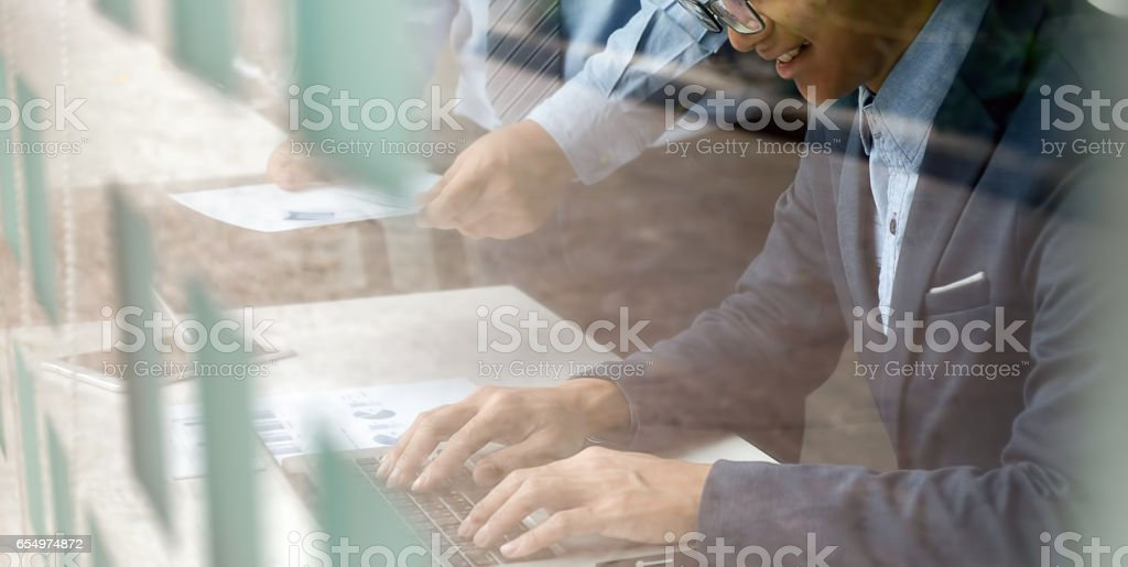 Double exposure photo.Man hand touching modern laptop.Investment manager working new private banking project office.Using electronic device. stock photo