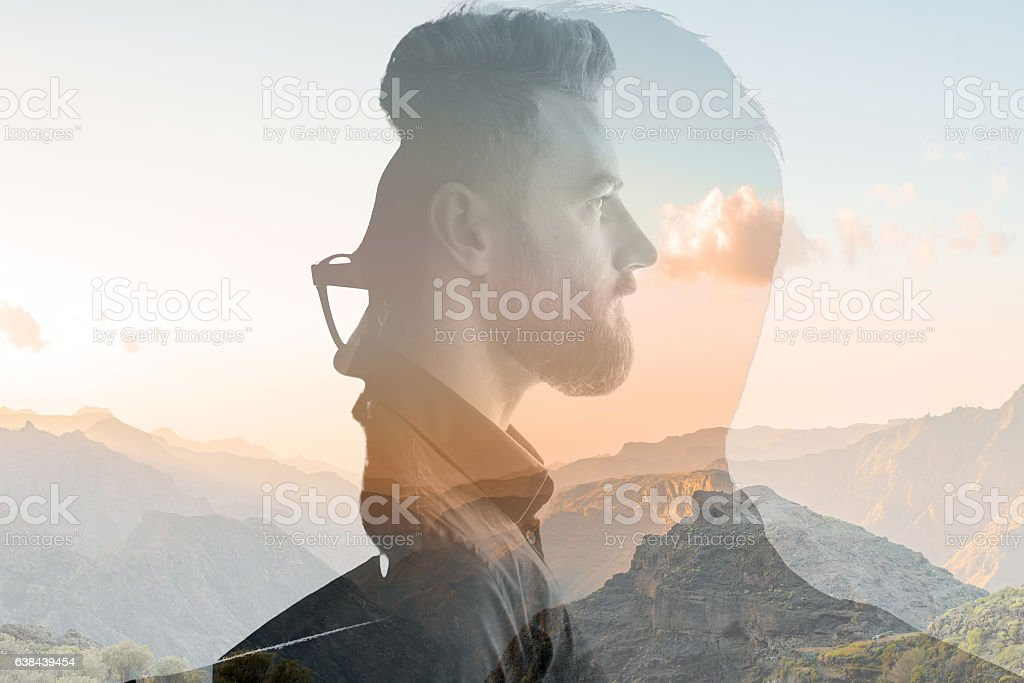 Double exposure portrait of a businessman stock photo