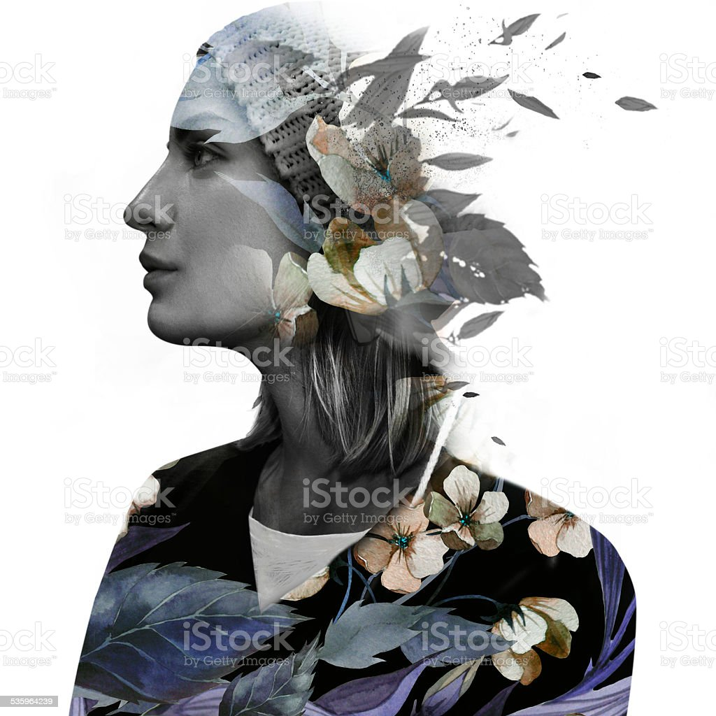 Double exposure portrait of a dreamy woman stock photo